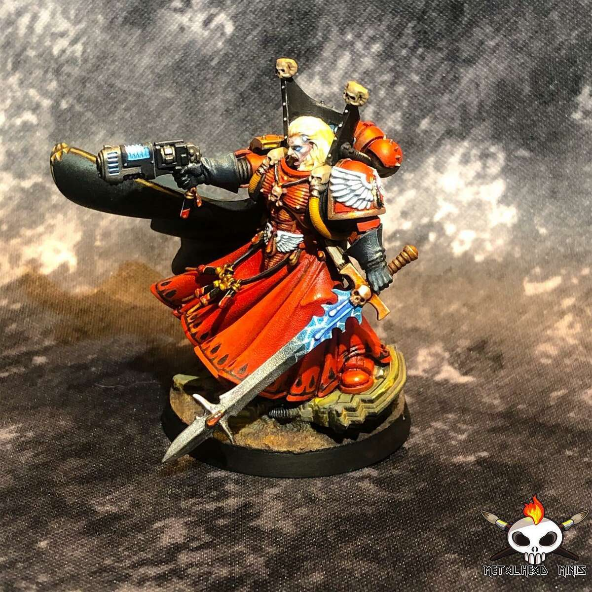 """Metalhead Minis founder Lyn Stahl incorporates all sorts of intricate details into her painted miniatures, as shown in this piece of the character Mephiston from the tabletop game """"Warhammer 40,000."""""""