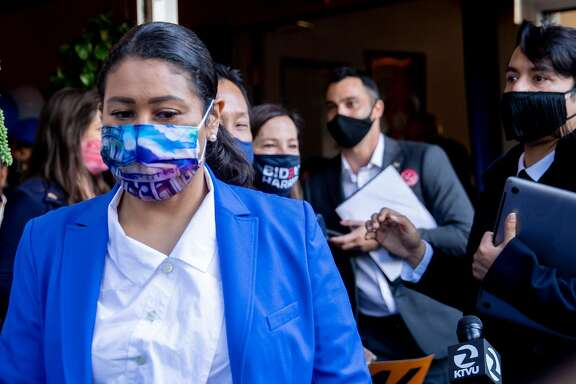 San Francisco Mayor London Breed wears a mask while walking to participate in phone banking for democratic candidates at Manny's cafe and communal space in San Francisco, Calif. Tuesday, November 3, 2020. California elected officials gathered to phone bank for Joe Biden and Kamala Harris as well as other democratic candidates in battleground states.