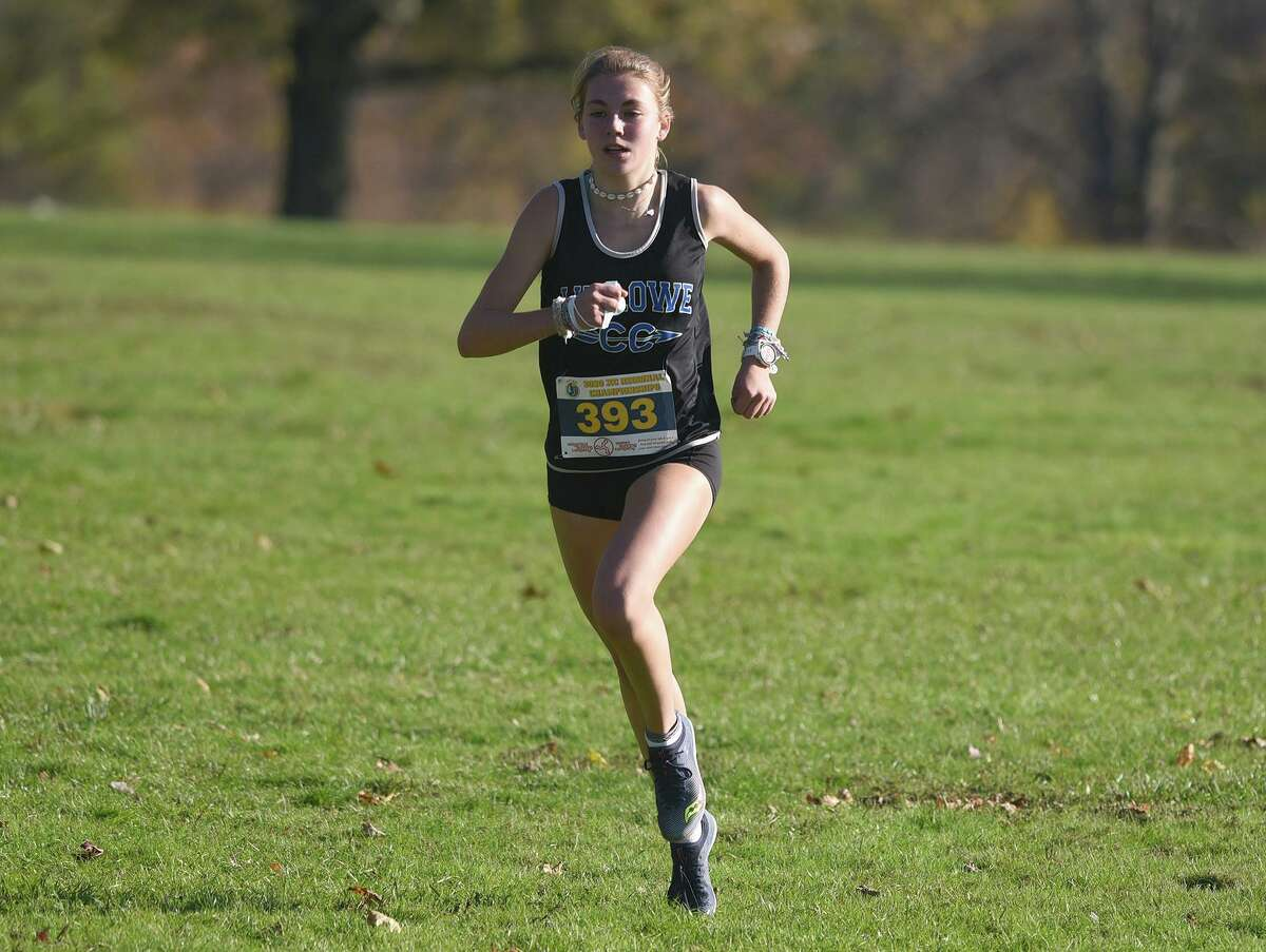 Ludlowe's Anna Keeley (393) runs to a victory in the FCIAC East girls cross country championship race in New Canaan's Waveny Park on Wednesday, Nov. 4, 2020.