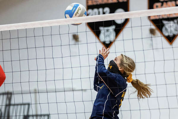The North Huron varsity volleyball team topped Caseville three games to none on Wednesday night in their district semifinal match-up. The Warriors won, 25-14, 25-4, 25-13.