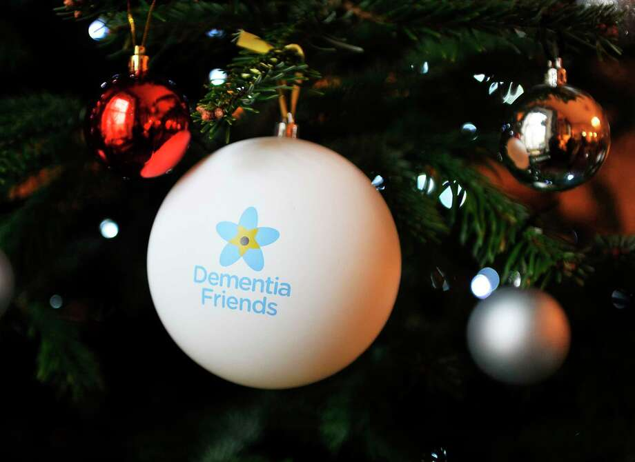 A Dementia Friendsornament hangs ona Christmas tree atan Alzheimer's Society campaign in London. To learn how to support thosewith dementia, contactArea Agency on Aging of Western Michigan and become a Dementia Friend.(Photo by Nick Ansell/PA Images via Getty Images) / PA Images