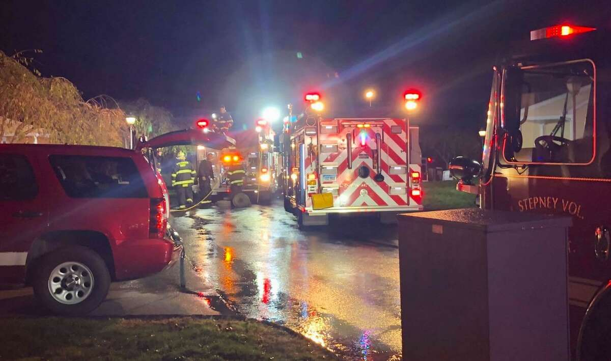 Crews on scene for a fire at the High Meadows condos on Highland Drive in Monroe, Conn., on Thursday, Nov. 5, 2020.