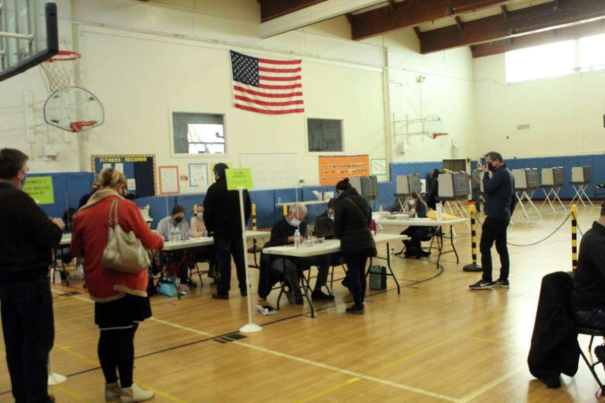 Weston voters gather in Weston Middle School's gym to vote on Election Day. Taken Nov. 3, 2020 in Weston, Conn.