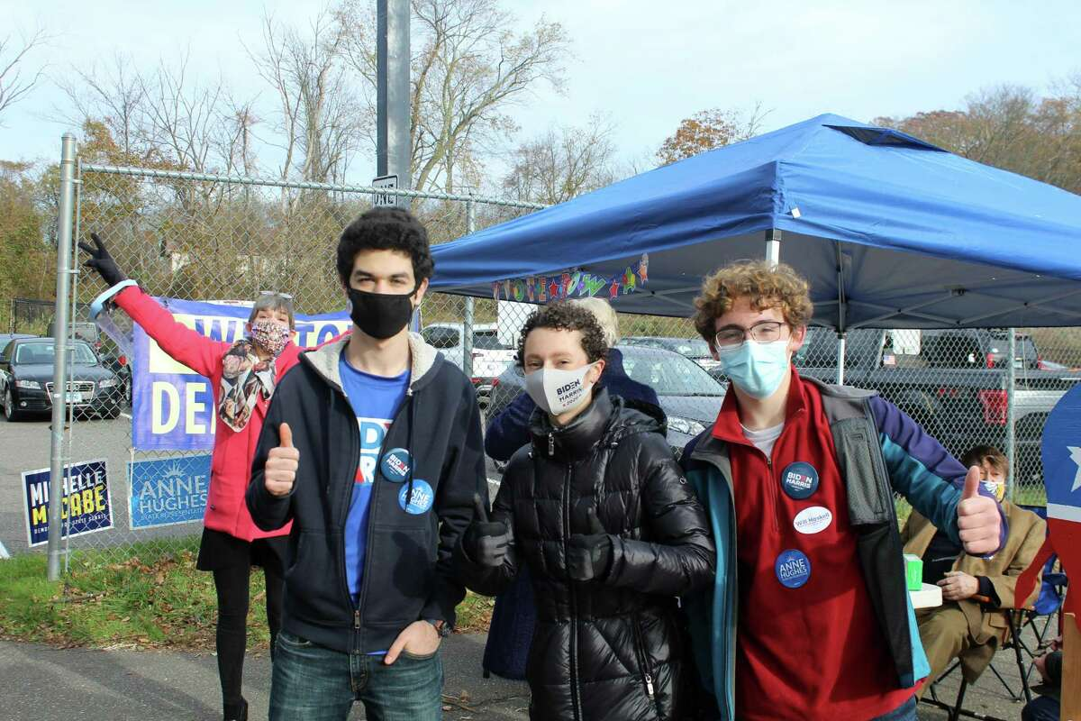 State Rep. Anne Hughes, left, and Weston High School students Jasper Richardson, Jonah Frimmer, and Eli Brennan outside of Weston Middle School on Election Day. Taken Nov. 3, 2020 in Weston, Conn.