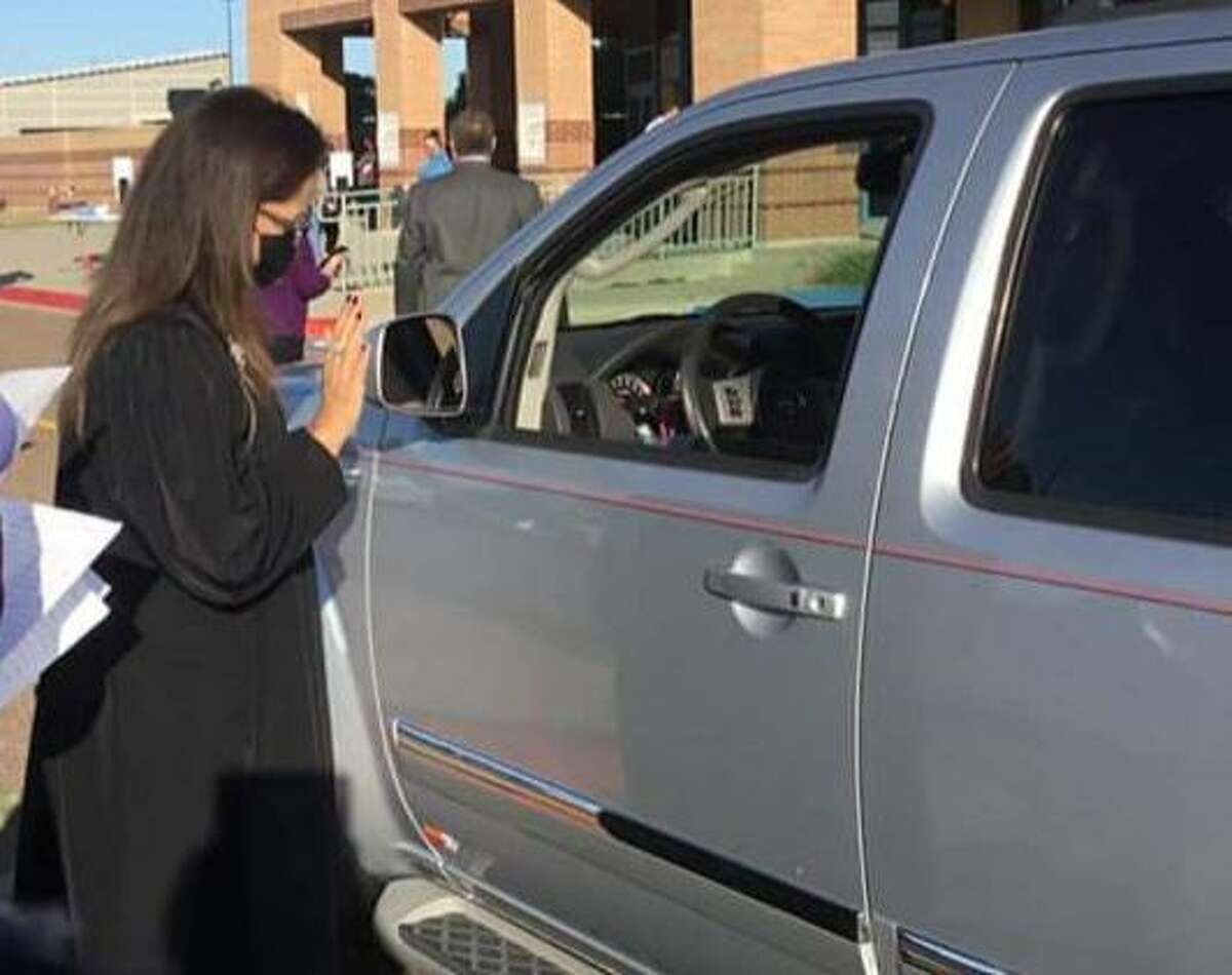 341st District Court Judge Beckie Palomo conducts drive-thru jury qualifications at the UISD Student Activity Center.
