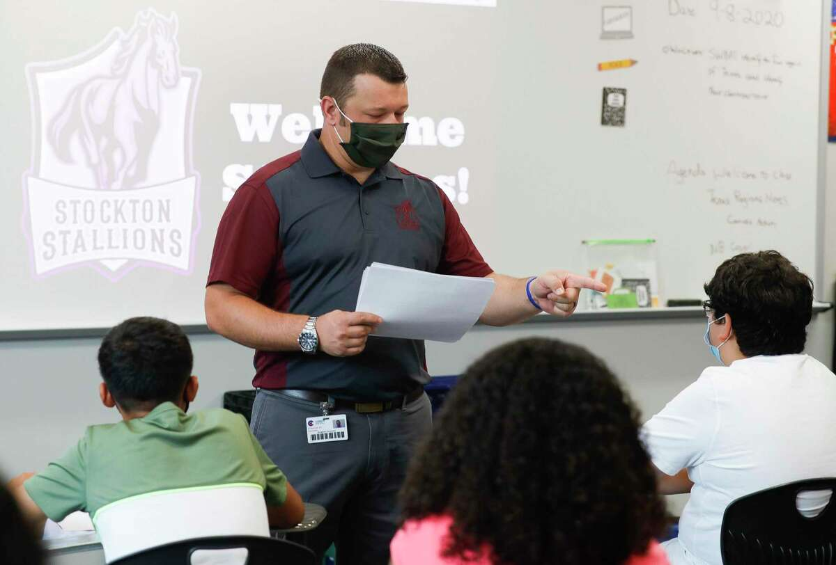Seventh grade history teacher Robert Simard instructs students at the start of class at Stockton Junior High School on the first day of in-person school for Conroe ISD on Sept. 8. The Conroe Independent School District is focused on finding more substitute teachers as hundreds of jobs go unfilled during COVID-19 because fewer substitutes have been willing to take jobs in the classroom.