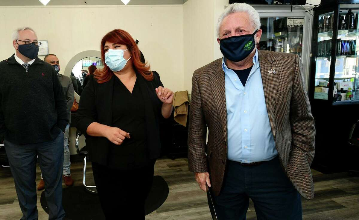 The International Beauty Academy founder Martha Interiano celebrates the grand opening with Norwalk Mayor Harry Rilling, right, Wednesday, November 3, 2020, at Krystal Hair Designers in Norwalk, Conn. Interiano has run Krystal Hair Designers on North Main Street fo 25 years.