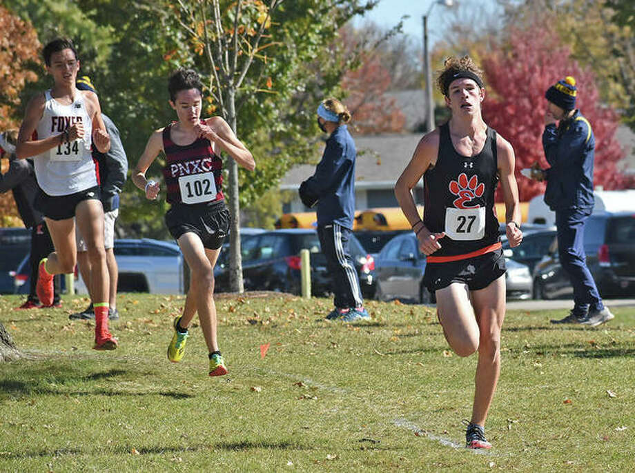 Edwardsville's Geordan Patrylak rounds one of the turns during the Class 3A Normal Community Sectional on Saturday in Normal. Photo: Matt Kamp|The Intelligencer