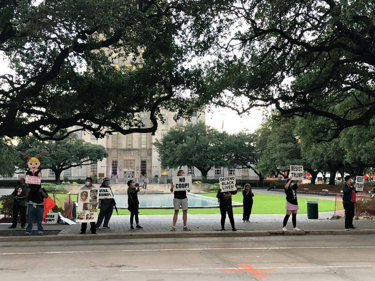 Protestors gather outside Houston City Hall Wednesday evening to protest President Donald Trump's efforts to curb vote counting in the 2020 election.