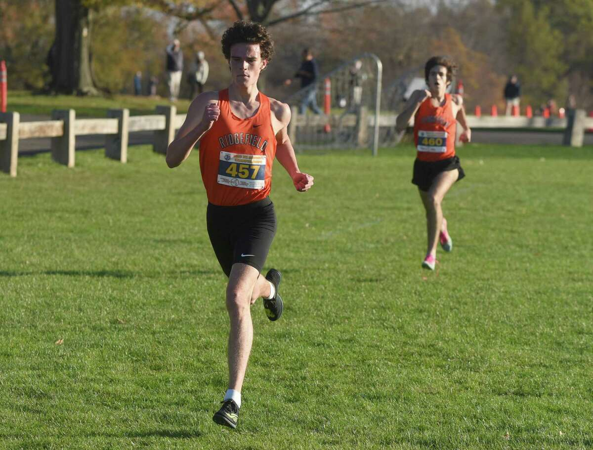 Ridgefield's Charlie King (457) and Chuckie Namiot (460) finished in the top two spots during the FCIAC East boys cross country championship race in New Canaan's Waveny Park on Wednesday, Nov. 4, 2020.