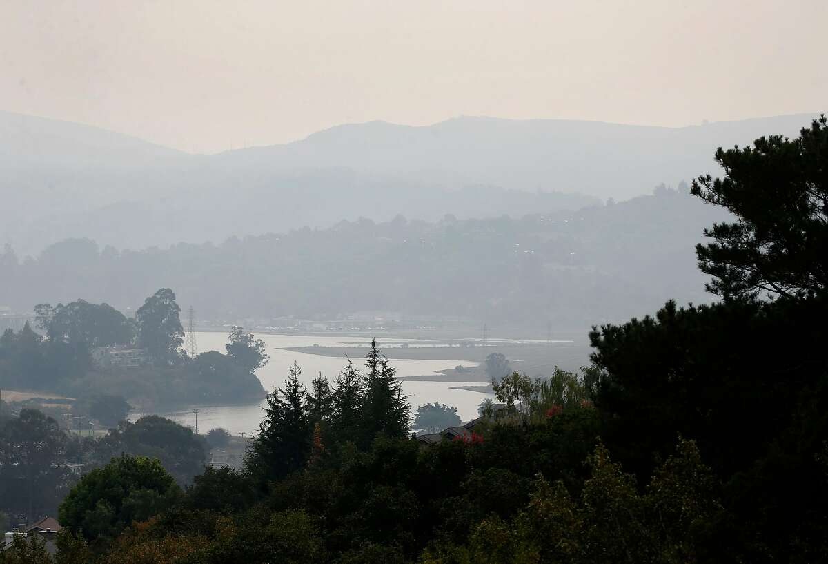 Smoke from the Glass Fire in Napa and Sonoma counties blankets Mill Valley last month. The state's fire season extends into December so even with precipitation this weekend, the risk will remain.