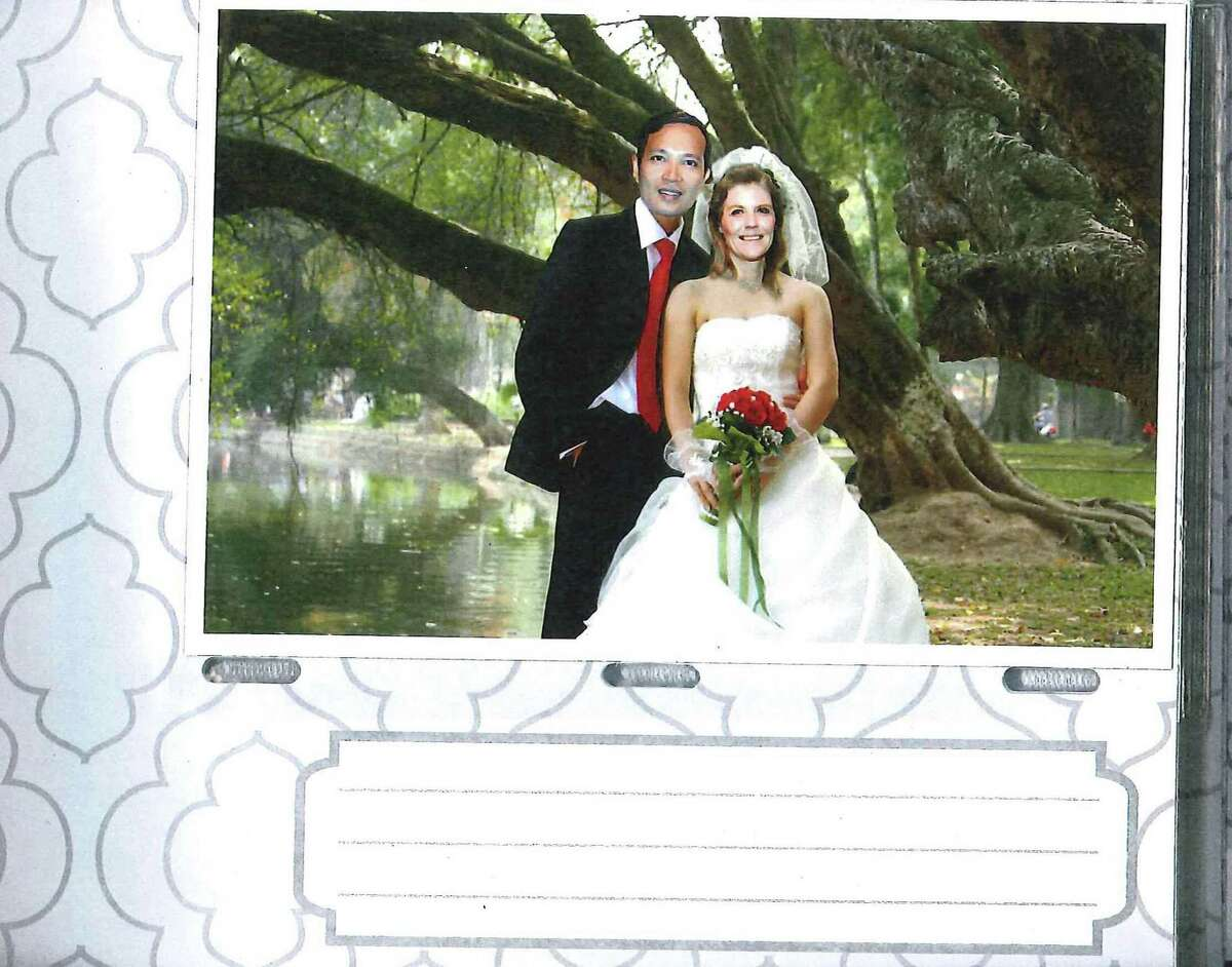 Photo from a wedding album of Nam Phuon Hoang and Brandy Lynn Esley. Photo albums were submitted as evidence by federal prosecutors in a wedding fraud scheme.