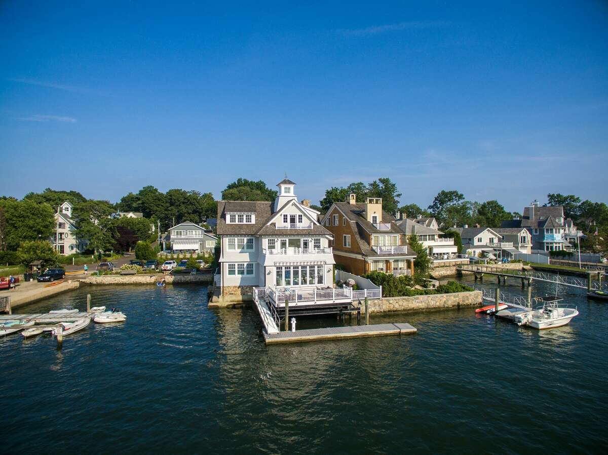 """57 Rowayton Avenue in Norwalk, CT. """"Rowayton's waterfront village feel is becoming increasingly popular, and the unique nature and design of this property led to a speedy and successful sale for everyone involved,"""" said Munro in the release. """"The home comes with a deep water dock, lovely water views, and inside has the look and feel of a chic Manhattan penthouse. It's the best of everything."""""""