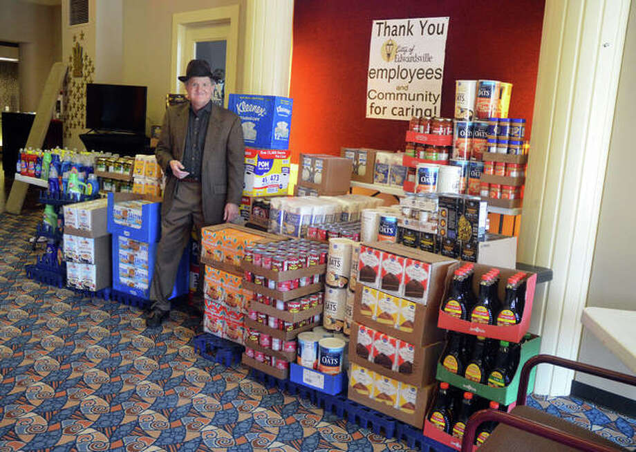 Wildey Theatre manager Al Canal with some of the items collected during the fifth annual City of Edwardsville Employee Food Drive. Photo: For The Intelligencer