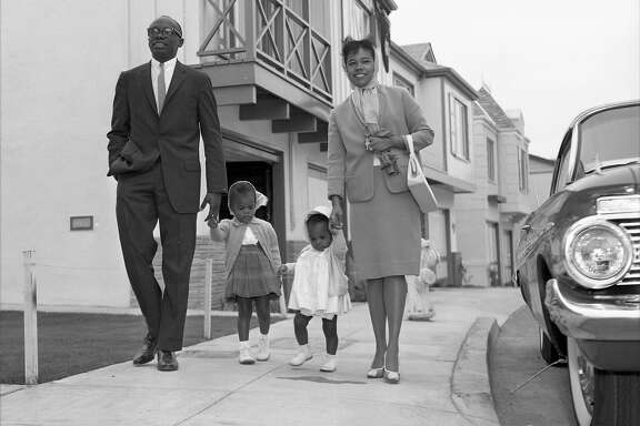 Attorney Willie Brown and his wife and children sit-in at a housing development in San Francisco, where they faced discrimination when they wanted to tour a new home, May 28, 1961