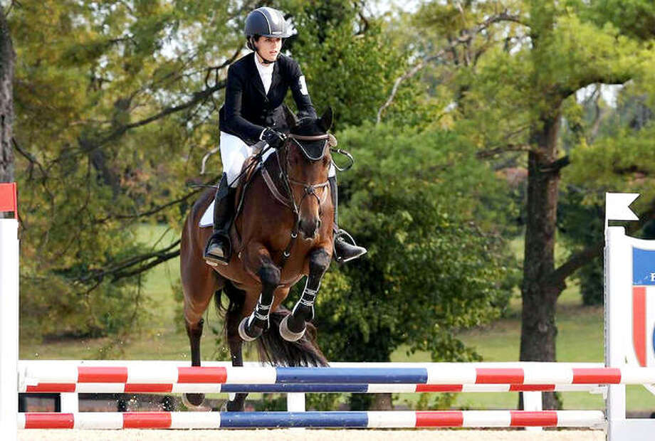 Principia College freshman Sissy Sugarman and her horse Carmani compete their first Fédération Équestre Internationale equestrian event recently in Lexington, Ky.. Photo: Principia Athletics