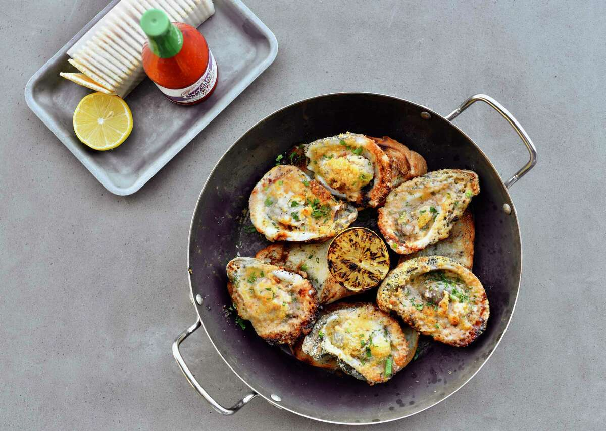 The Prestige (grilled oysters with grated parmesan and fresh herb and shallot butter) at Pier 6, a new Gulf seafood restaurant in San Leon.