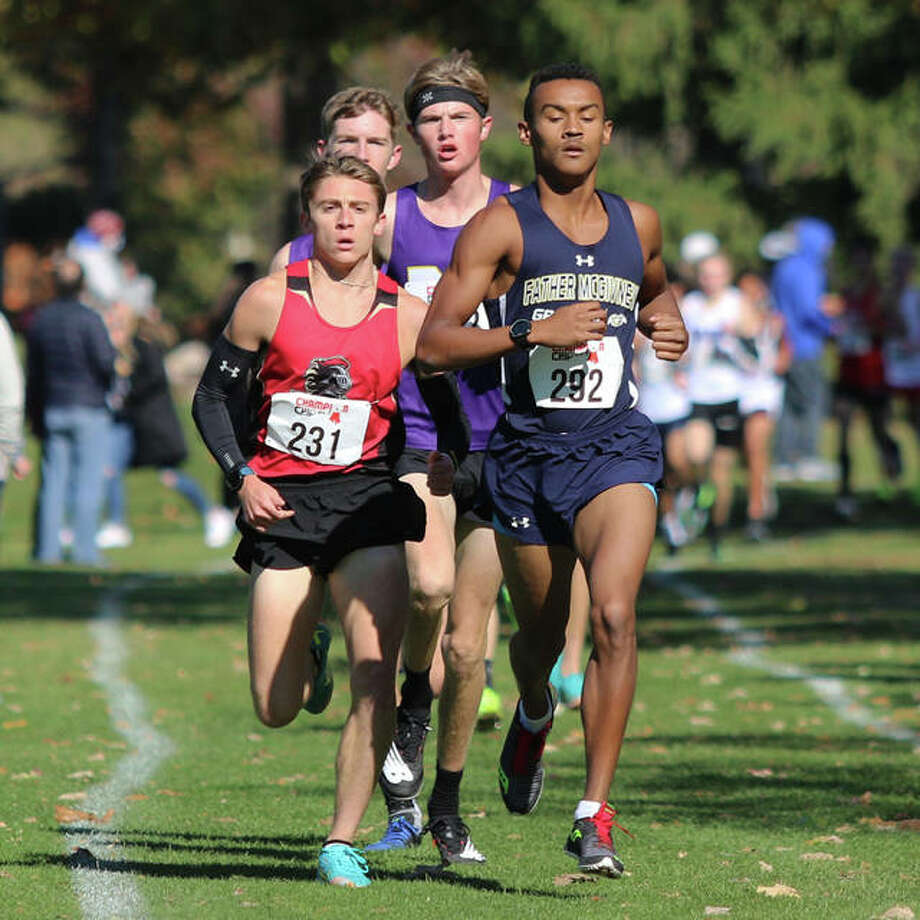 Father McGivney's Tyler Guthrie (right) and Arthur's Layton Hall (left) lead the field midway through the opening mile of the Decatur St. Teresa Class 1A Sectional on Saturday at Hickory Point golf course in Forsyth. Hall won the race, with Guthrie finishing second. Photo: Greg Shashack | The Telegraph