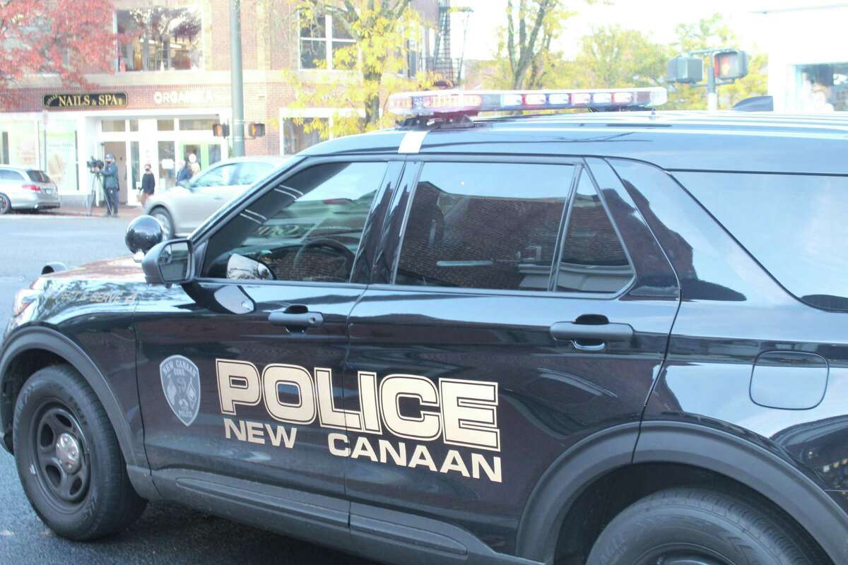 A New Canaan Police vehicle at an incident downtown.
