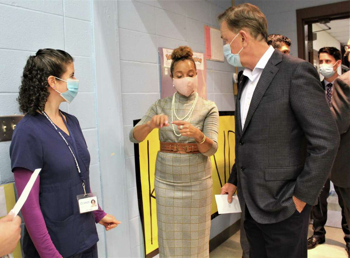 Gov. Ned Lamont, right, learns about BinaxNOW™ COVID-19 testing, which is taking place throughout the Middletown Public Schools as part of a pilot program with the Community Health Center and state of Connecticut. He is shown at Macdonough Elementary School on Spring Street Thursday. At center is Yvette Highsmith, vice president of Community Health Center's Eastern Region.