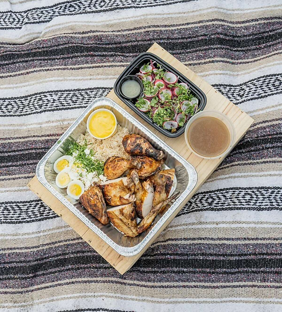 A chicken picnic meal prepared by Keone Koki and Bilal Ali as part of their latest project, Michoz, at the Hidden Cafe in Berkeley.