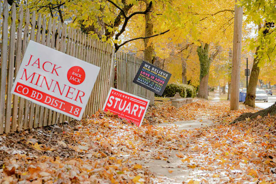 Political yard signs like these near the fence of a home on Troy Road in the Leclaire Historic District are recyclable. Photo: Tyler Pletsch   The Intelligencer