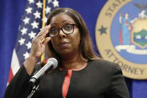New York State Attorney General Letitia James is monitoring the election litigation brought by the President Donald Trump campaign and could intervene in cases in other states to defend state election law. In this photos, she adjusts her glasses as she announces that the state is suing the National Rifle Association during a press conference, Thursday, Aug. 6, 2020, in New York.  (AP Photo/Kathy Willens)