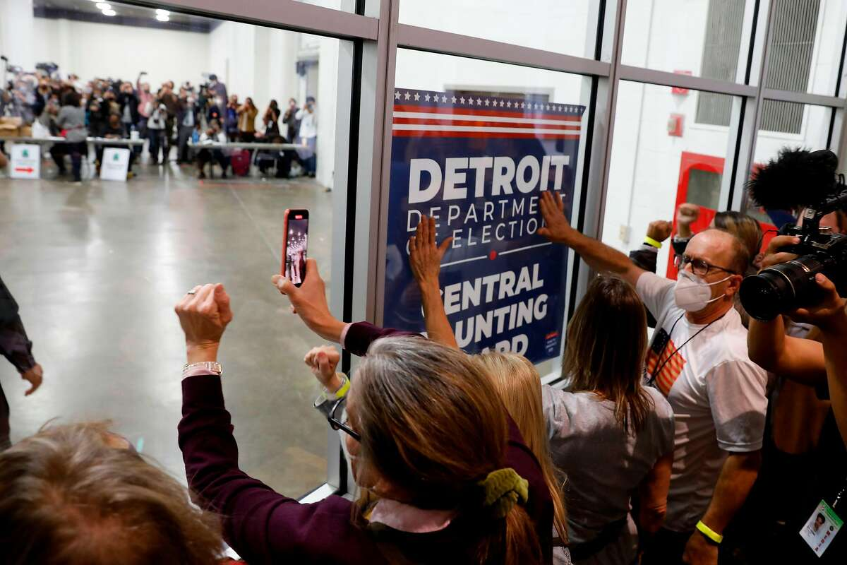 """Supporters of President Trump bang on windows and chant slogans such as """"Stop the count!"""" outside the room where absentee ballots are being counted Thursday in Detroit."""