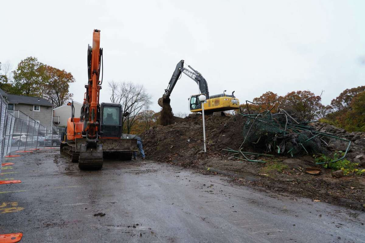 Earth movers are prepping for construction at Canaan Parish,186 Lakeview Ave. in New Canaan where two four-story buildings will replace the 10 affordable housing buildings. The trucks were busy Thursday, Oct. 9, 2020.