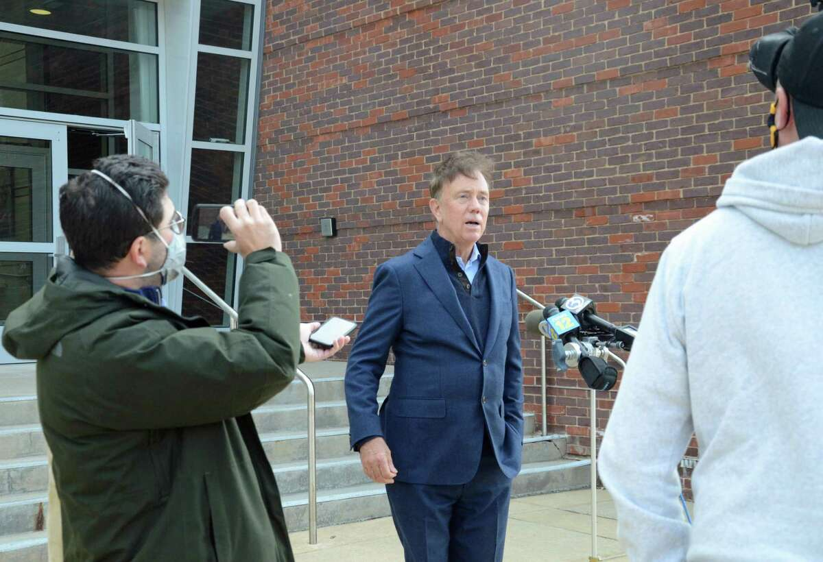 The Governor Ned Lamont speaks to reporters on Election Day 2020 outside Greenwich High School's performing arts center.