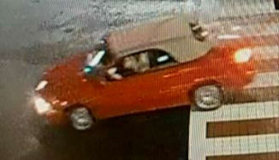 This red car was seen around the area just before and after the Discount Store was burglarized two weeks ago. The Stamford police are seeking more information about it and two area burglaries. Photo: Surveillance Photo / Courtesy Of Stamford Police Department