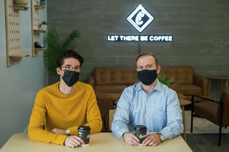 Creation Coffee owners Ben Marsh, left, and Jacob Spence, right, pose for a portrait Thursday inside the business at 5023 Eastman Ave. in Midland. (Katy Kildee/kkildee@mdn.net)
