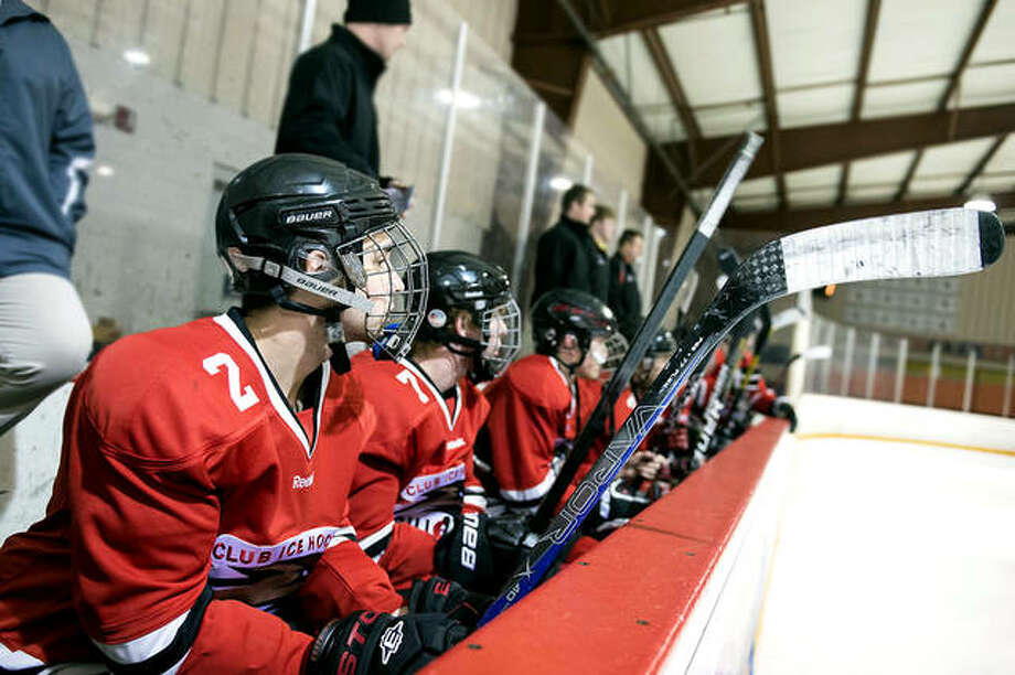 The SIUE hockey team's season, which had already been postponed because of the COVID-19 pandemic, remains in limbo because of hockey's classification as a high risk activity. The Cougars, who would have started practice under normal conditions, have not started official training yet. The team is shown on the bench during a previous season. Photo: Telegraph File Photo