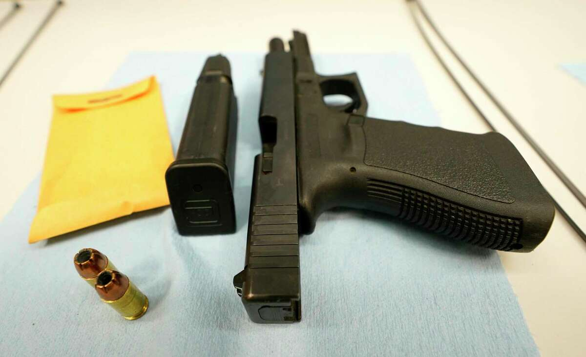 A handgun is shown in the test firing area at the Bureau of Alcohol, Tobacco, Firearms and Explosives headquarters during a media conference with the Houston Police Department about the Crime Gun Strike Force Thursday, Nov. 5, 2020 in Houston.
