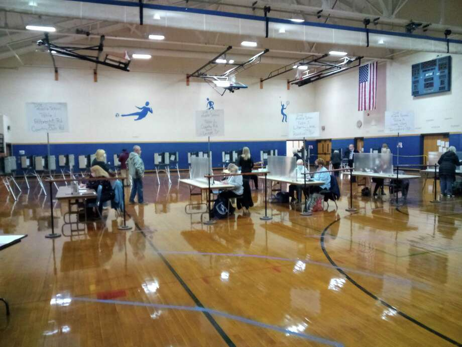 Town and city clerks and registrars of voters worked hard to keep Election Day voting running smoothly, in spite of many challenges. Above, voters cast their ballots at Torrington Middle School Nov. 3. Photo: Emily M. Olson / Hearst Connecticut Media