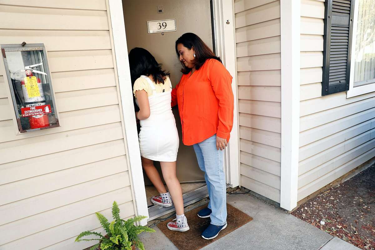 Aleida Ramirez and her daughter, Emily, 11, enter their apartment at Clayton Crossing Apartments , Calif., on Monday, November 2, 2020. Ramirez has joined other tenants in fighting a rent increase and poor living conditions.