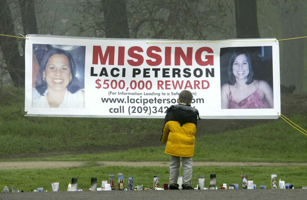 A young child stops to look at a makeshift memorial for Laci Peterson at the East La Loma Park January 4, 2003, in Modesto.