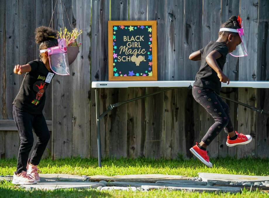 Paetyn Jackson, 4, and Chandler Palmer, 4, play before a backyard, which is designed like a school play ground. Photo: Mark Mulligan, Houston Chronicle / Staff Photographer / © 2020 Mark Mulligan / Houston Chronicle