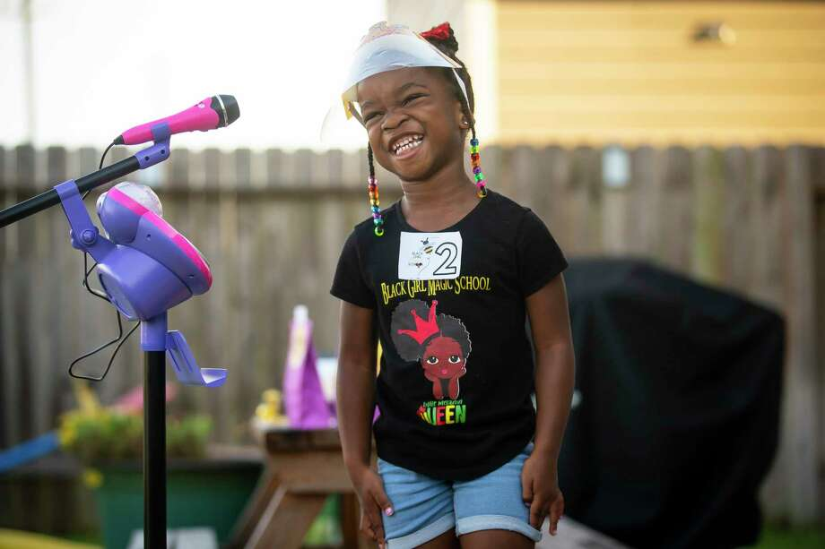 Urennaya Unaka, 4, laughs as she answers a question. Photo: Mark Mulligan, Staff Photographer / © 2020 Mark Mulligan / Houston Chronicle