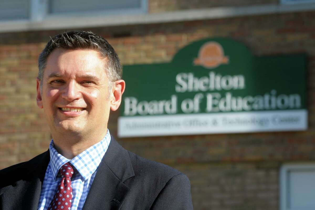 Newly promoted Superintendent of Schools Ken Saranich poses in front of the Board of Education offices in Shelton, Conn. Nov. 5, 2020.