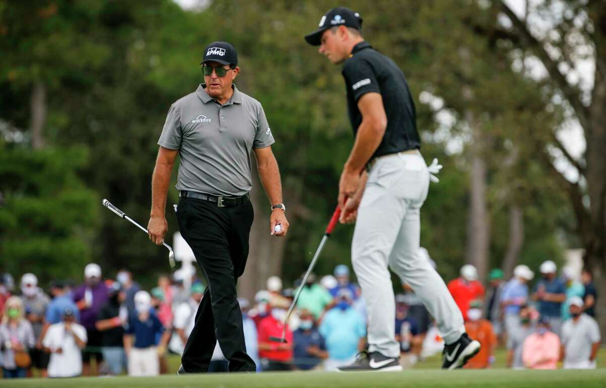 Phil Mickelson watches a putt by Viktor Hovland on the 15th hole during the first round of the Vivint Houston Open on Thursday, Nov. 5, 2020, at Memorial Park Golf Course in Houston.