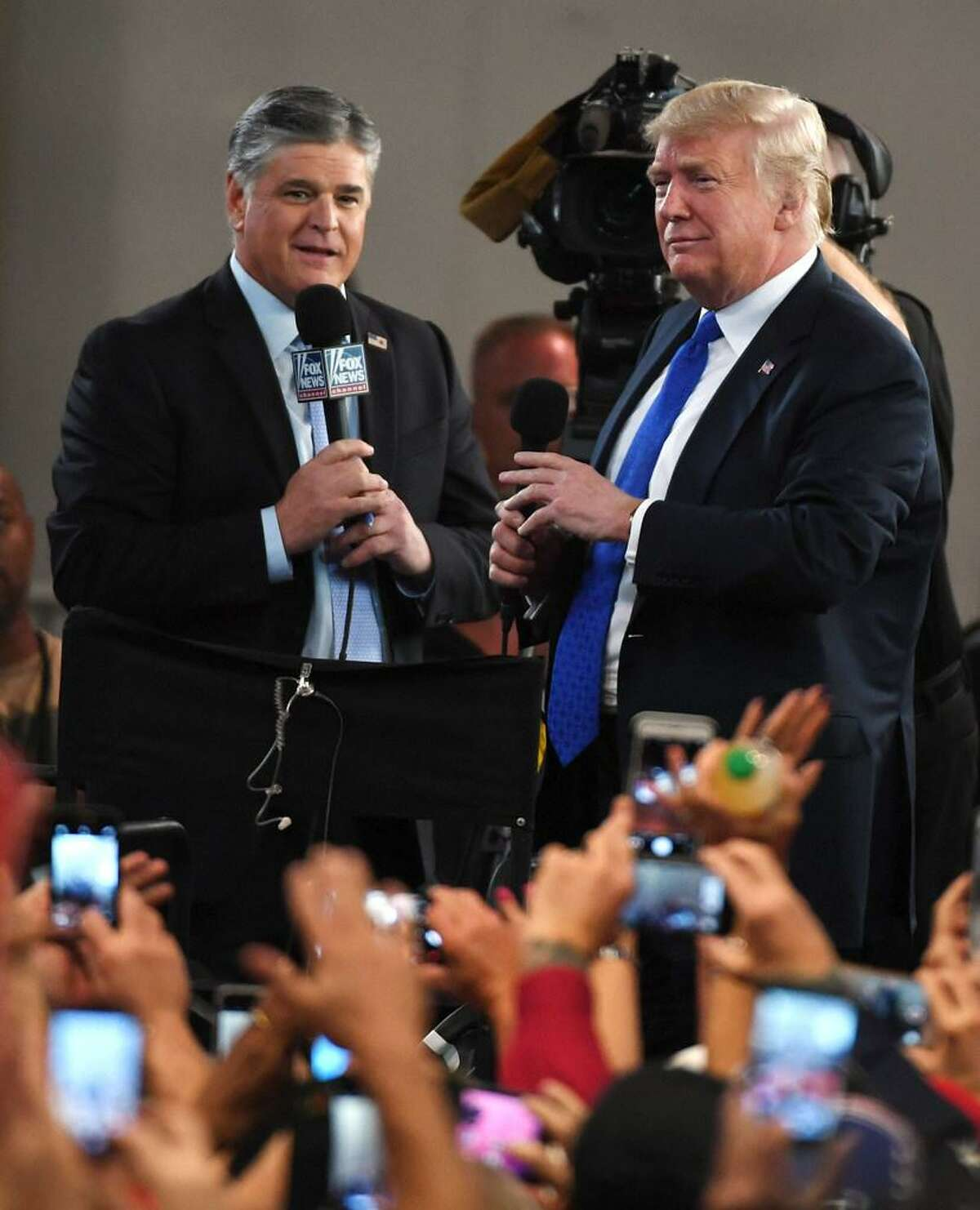 Fox News Channel and radio talk show host Sean Hannity (L) interviews U.S. President Donald Trump before a campaign rally at the Las Vegas Convention Center on September 20, 2018 in Las Vegas, Nevada.