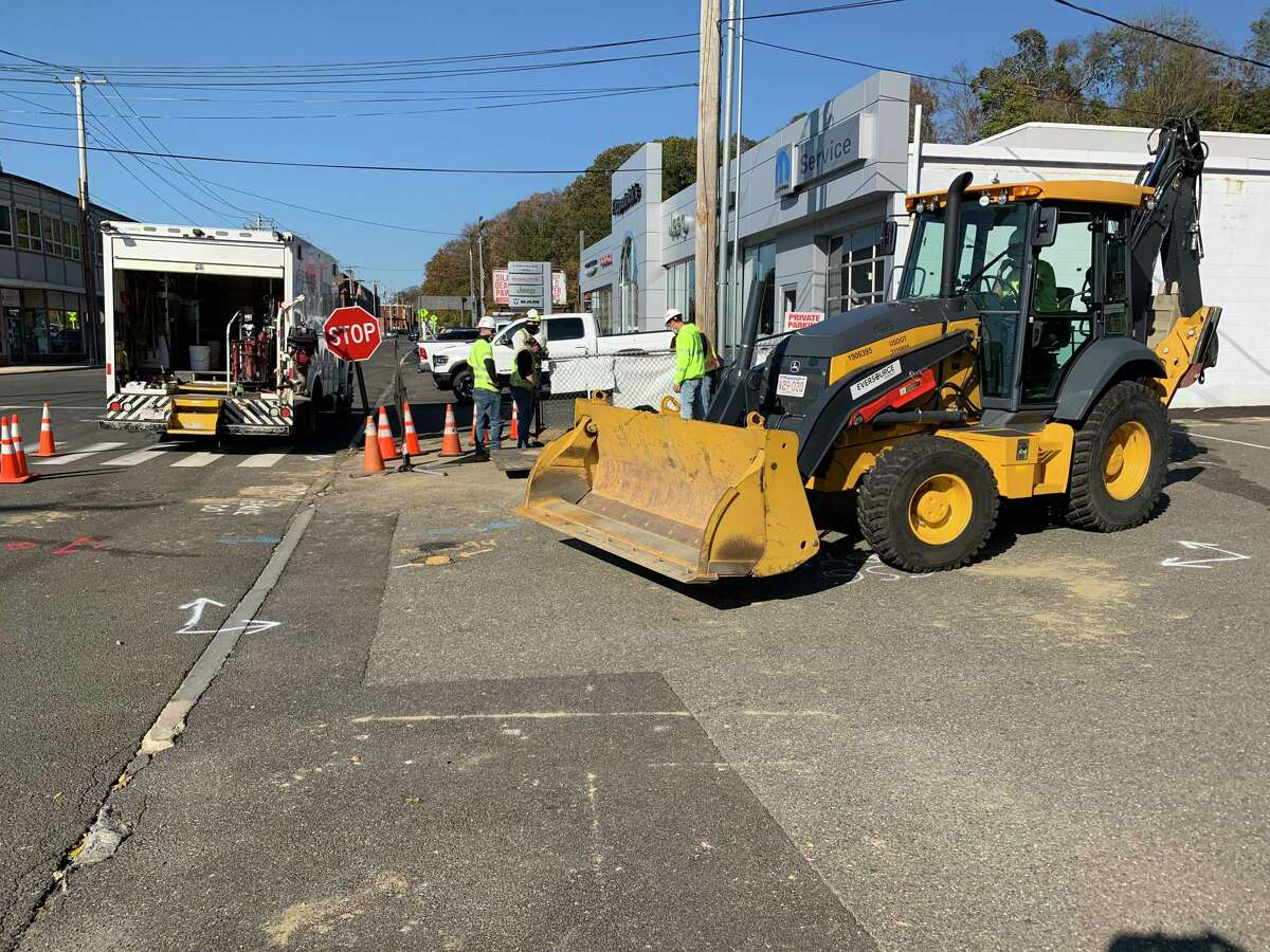 Eversource crews repair a pipeline in downtown Ansonia near the Fitzpatrick's car dealership Wednesday. Some 2,500 customers on Ansonia's and Derby's Hilltop were without service for much of two days.