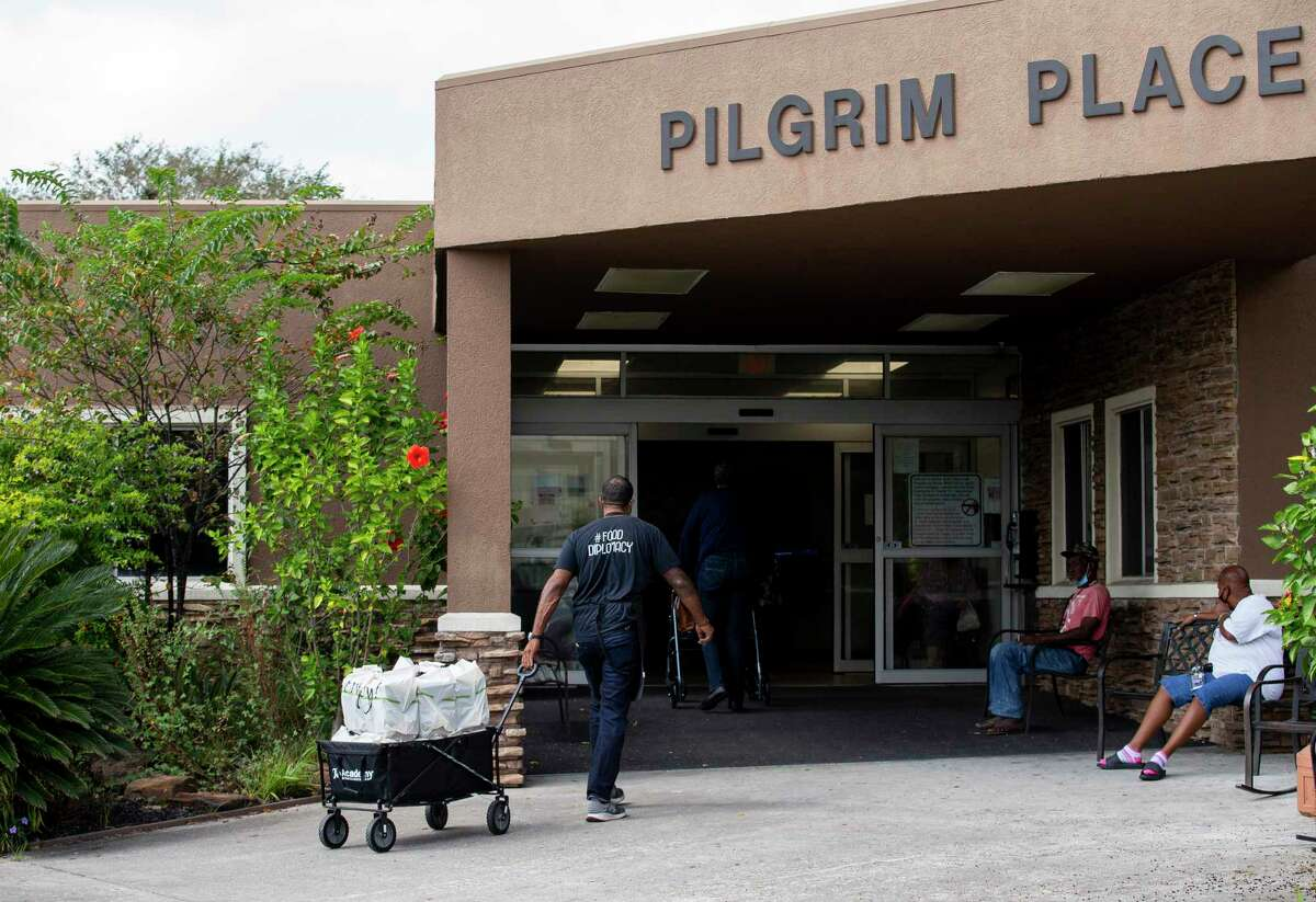 Chris Williams delivers meals to Pilgrim Place in north Houston, the last stop of six apartment buildings that day.