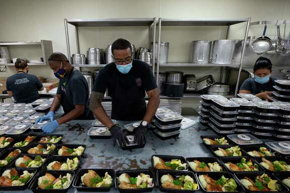 Chris Williams and his team assemble meals for seniors in need during the pandemic as part of Lucille's 1913, a new nonprofit.