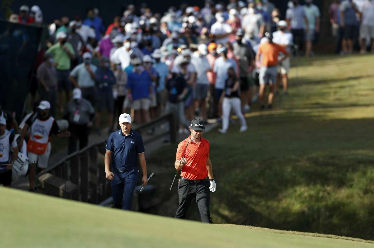 Jordan Spieth and Lanto Griffin walk to the on the seventh green during the first round of the Vivint Houston Open at Memorial Park Golf Course on Thursday, November 5, 2020.