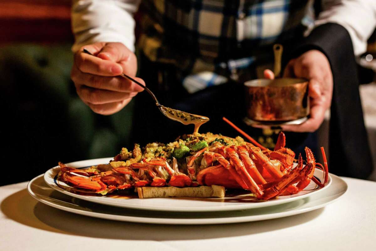 Lobster Thermidor is served tableside at Turner's, the clubby dining room set within The Annie Cafe & Bar.