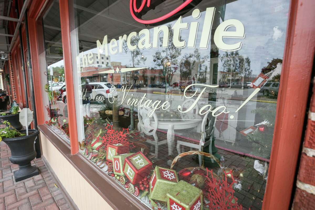 Christmas themed decorations line the windows of The Mercantile on Friday, Dec. 9, 2016, in downtown Conroe. Holiday displays will be up by Thanksgiving in the downtown businesses.