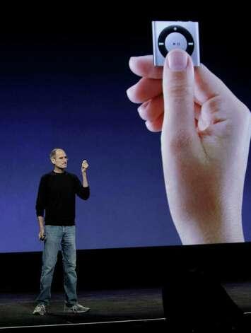 Apple CEO Steve Jobs hols up the new Apple iPod Shuffle at a news conference in San Francisco, Wednesday, Sept. 1, 2010. (AP Photo/Paul Sakuma) Photo: Paul Sakuma / AP