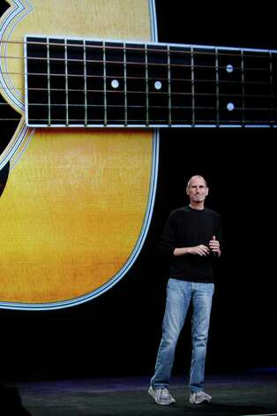 Apple CEO Steve Jobs smiles during a news conference, Wednesday, Sept. 1, 2010, in San Francisco. (AP Photo/Paul Sakuma) Photo: Paul Sakuma / AP